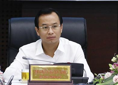 Bí thư Đà Nẵng Nguyễn Xuân Anh đồng chủ trì buổi họp báo sáng 31/12. Ảnh: Ngọc Trường.